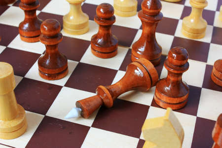 Chess king lies on a chessboard