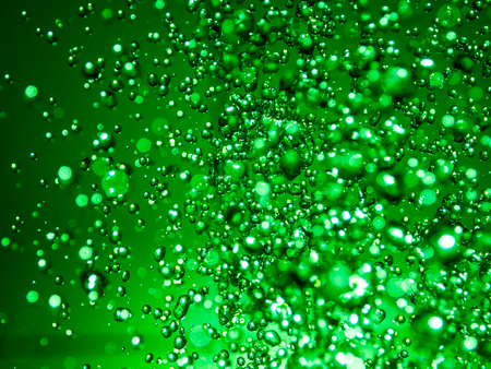 Green water abstract splashes bokeh.