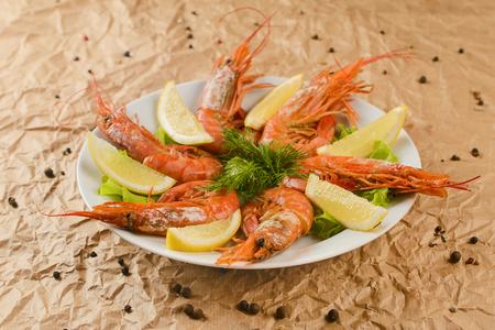 fried shrimps with lemon on plate