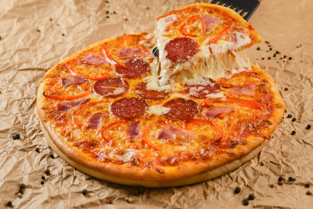Hot pizza on craft paper background