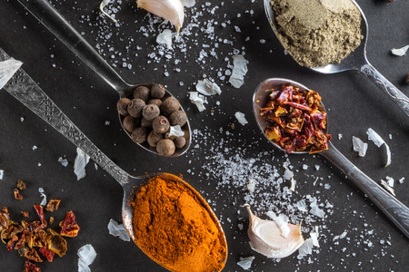 Colorful spices in dark background