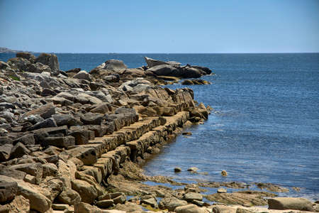 Stones of an old fishing pier on the Atlantic coast