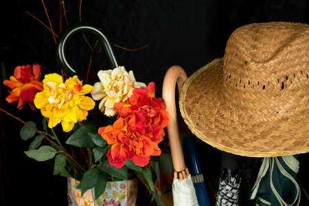 A hat, flowers and an umbrella. the four Seasons of the year