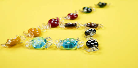Several glass candies similar to the real ones