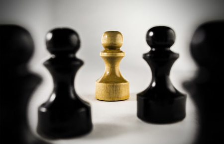 chessmen: A few black chessmen and one white chessman