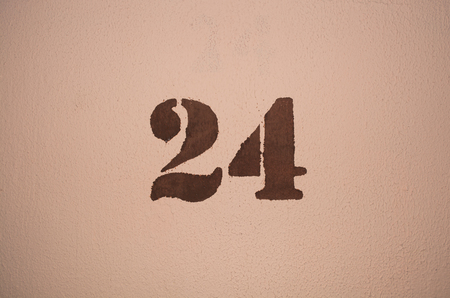numerics: The number twenty four painted on the wall Stock Photo