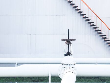 Manual butterfly valves on oil and gas pipeline in oil tank farm.