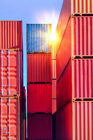 Containers stack inside container yard with sunray. Container port terminal operations.