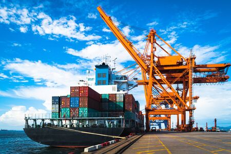 Big ship working at port, large container ship loading, and discharging container cargo. Container port terminal operations. Stock Photo