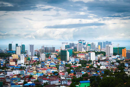 Sihanoukville, Cambodia- July 06, 2020: High angle view of city and high rise building under construction. Fast growing economy from Chinese investment.