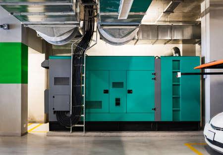 Huge backup electrical power generator in office building.