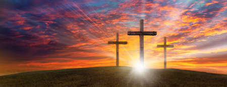 Wood cross of Jesus crucifixion and resurrection with bursting sunray background. Christianity and spiritual concept.