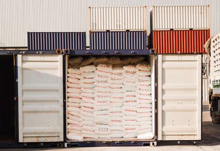 Rice bags stuffed in containers at a warehouse for export.