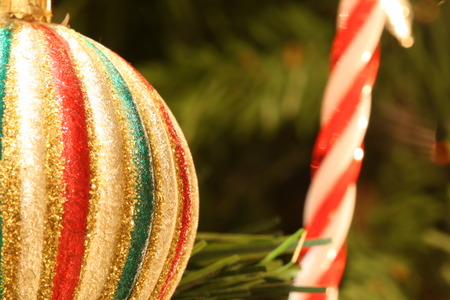 tree detail: colorful striped Christmas ball on Christmas tree detail Stock Photo
