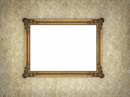 Golden, empty, ornate frame over aged, vintage wallpaper. photo
