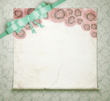 Vintage wedding background with roses, floral green wallpaper with ribbon and bow,  white blank for insert your text (design). photo
