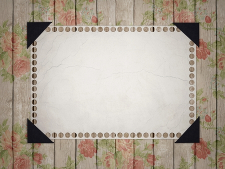 wooden insert: Notebook paper. Grunge page pasted to a wooden, floral background.