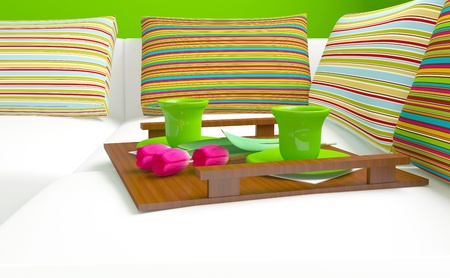 nice accommodations: Colorful pillows and coffee with a flowers on the white sofa, home interior.