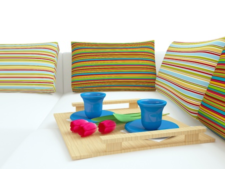 nice accommodations: Colorful pillows and coffee on the white sofa, home interior.