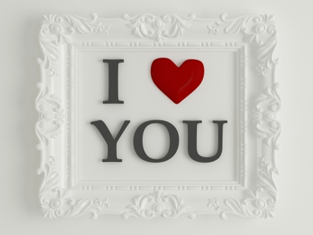 love image: antique white frame labeled - I love you, in front of white wall, similar variations in my portfolio Stock Photo