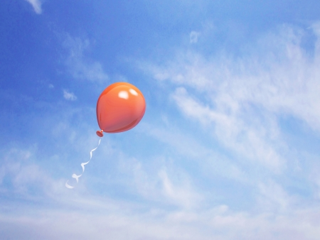 Single orange balloon in the blue sky, 3d render Stock Photo
