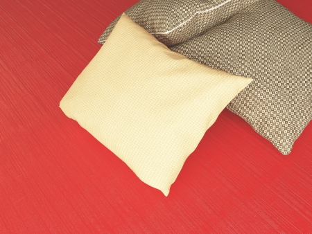 Brown textile pillows on the red floor, 3d render. Stock Photo - 15430203