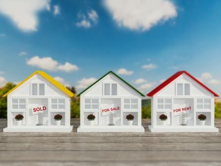 Drie kleine witte huizen te koop, te huur. Groene bomen en een blauwe lucht op de achtergrond.