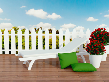 patio furniture: Outdoor patio area with white sunlounger and roses. Stock Photo