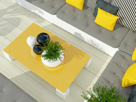 Terras zithoek met een grote bank en een tafel.