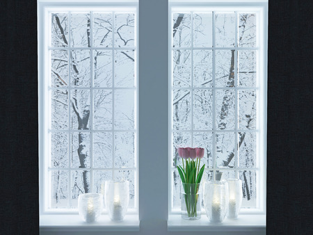 Cozy room. Candlesticks and flowers on a windowsill. Winter landscape through the window. Stock Photo