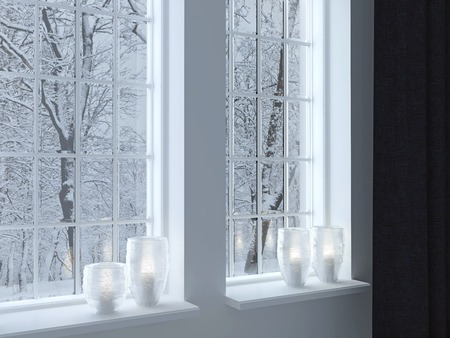 white winter: Cozy room. Candlesticks on a windowsill. Winter landscape through the window.