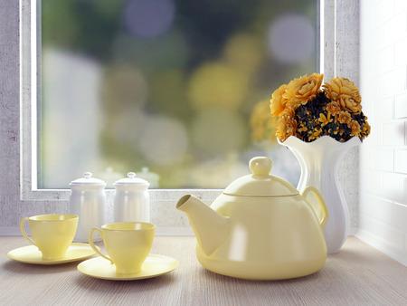 Ceramic tableware on the wooden worktop. White kitchen design. Stock Photo