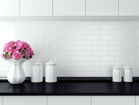 Ceramic tableware on the worktop. Black and white kitchen design. Stock Photo