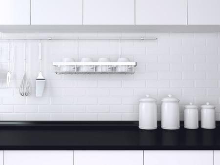 Utensils and kitchenware on the worktop. Black and white kitchen design.