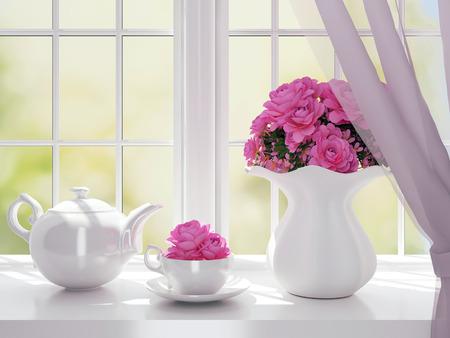 Boeket roze bloemen (rozen) en witte service op een vensterbank.