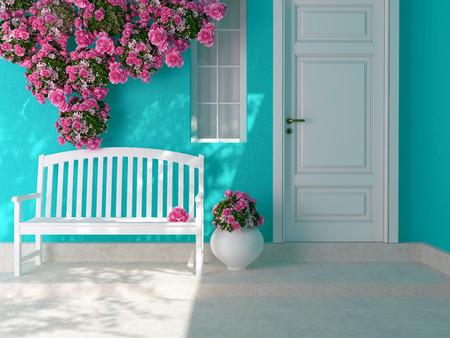 Vista frontal de uma porta branca de madeira em uma casa azul com janela. Rosas bonitas e banco na varanda. Entrada de uma casa.