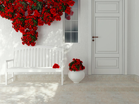 Front view of a wooden white door. Beautiful red roses and bench on the porch. Exterior of a house.