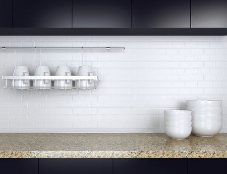 worktop: Ceramic kitchenware on the marble worktop. Black and white kitchen design. Stock Photo