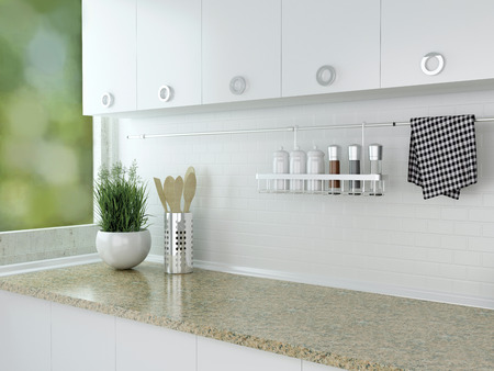Kitchenware and utensils on the marble worktop. White kitchen design.