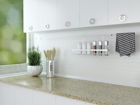 Kitchenware and utensils on the marble worktop. White kitchen design.