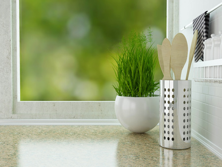 Wooden utensils on the marble worktop. White kitchen design. Stock Photo