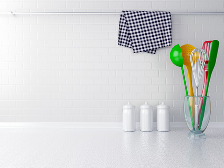 Colour utensils on the white worktop. Kitchen interior. Stock Photo