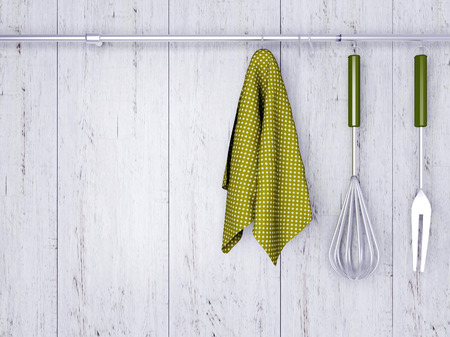 cooking implement: Kitchen cooking utensils. Steel spatulas, whisk and towel in front of rustic white wooden wall.