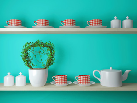 White teapot and cups on the shelf in front of blue wall.  photo