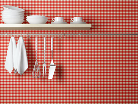 White plates on the shelf, kitchen cooking utensils. Steel spatulas, whisk and towel in front of rustic red wall.