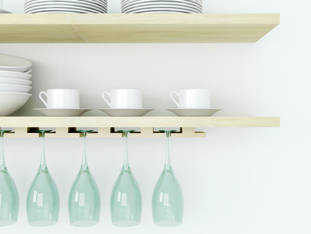 shelf wall: White ceramic kitchenware and wineglasses on the wooden shelf in front of white wall.