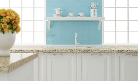 Kitchenware on the shelf in front of big light window. White and blue kitchen design. Stock Photo