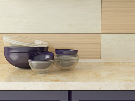 Ceramic and glass kitchenware on the marble worktop. photo