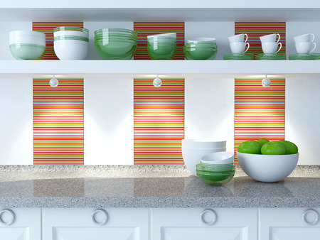 Modern white kitchen design. Ceramic and glass kitchenware on the shelf. Vase with apples on the marble worktop. photo