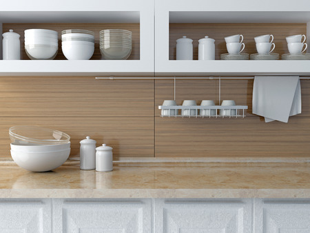Modern kitchen design. White ceramic kitchenware on the marble worktop. Plates, cups on the shelf.